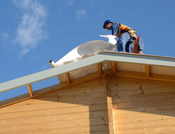 Roofing Contractor Installing a New Roof In Michigan